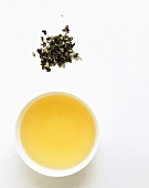 Tightly twisted green tea leaves