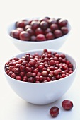 European cranberries in a bowl, American cranberries behind