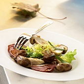 Cep salad with slices of duck breast
