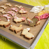 Animal-shaped Easter biscuits on a baking tray