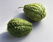 Two spiny chayote fruits
