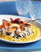 Shrimp tails on wild rice mixture with cranberries