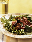 Salad leaves with slices of roast beef
