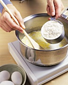Stirring flour into butter (making choux pastry)