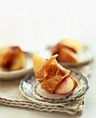 Peach wedge wrapped in air-dried ham