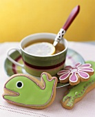 Animal-shaped biscuits with tea