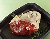 Leg of venison studded with rosemary & garlic in roasting tin