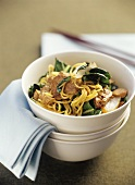 Asian noodle dish with chard and pieces of meat