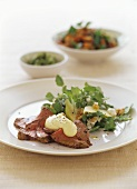 Pieces of roast beef with autumn herb salad