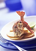King prawns with herb sauce on potato slices