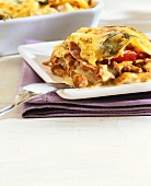 A piece of chanterelle lasagne on a plate