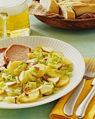 Potato and cabbage salad with apple, served with smoked pork