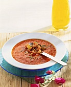 Creamed tomato soup with shrimps and peach