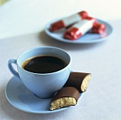 A cup of coffee with marzipan bar