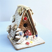 Crispy gingerbread house with witch