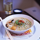 Asian noodle soup with seafood