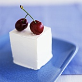Set yoghurt dessert with two cherries