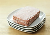 Frozen mince lying on a plate to thaw