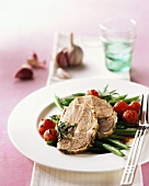 Roast pork with green beans and cocktail tomatoes