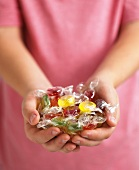 Assorted fruit sweets, in someone's hands