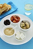 Assorted antipasti in small bowls