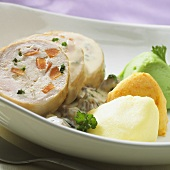 Stuffed chicken roll, sliced, with vegetable puree