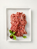 Fresh minced pork on a rectangular plate