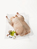 A whole Peking duck on greaseproof paper