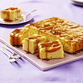 Tray-baked apple cake with caramel sauce