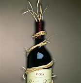 Rioja wine bottle wrapped in raffia