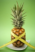 Pineapple with tape measure round it