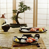 Assorted sushi on table laid in Japanese style