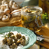 Pickled mushrooms in jar and with rice
