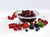 Rumtopf in bowl, fresh fruit in front