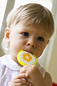 Small child with a lollipop