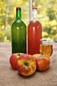 Organic apple juice, three apples in front