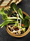 Asian vegetables in steaming basket