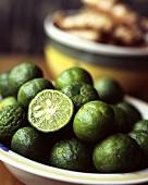Limes and kafir limes in a bowl