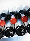 Wine bottles in a pile in fridge