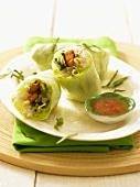 Vietnamese spring rolls with dip on plate