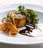 Potato flan with carrot crisps, gravy and herbs