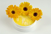 Marigold ointment with three flowers
