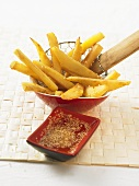 Sweet potato sticks with honey sesame sauce (China)