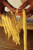 Woman holding ribbon pasta in her hands
