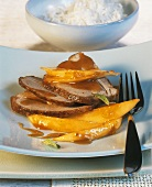 Sliced turkey leg with mango chutney
