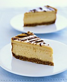 Two pieces of cheesecake with sugar syrup