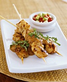 Chicken kebabs with peanut sauce and avocado salad