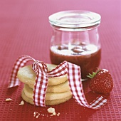 A pile of biscuits with strawberry jam