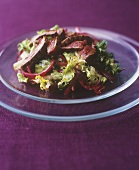Salad leaves with beetroot and duck breast