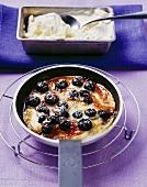Caramelised blueberry pancake with vanilla ice cream